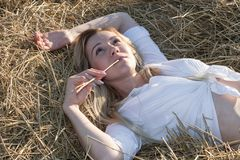 Beautiful girl dreaming in the straw stock images