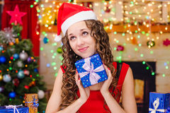Beautiful girl dreams of a Christmas gifts Royalty Free Stock Photography