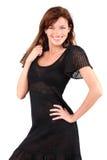 Beautiful girl in dress and bid earrings smiles Royalty Free Stock Images