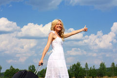 Beautiful girl in dress. Beautiful blond woman in a white sundress travels royalty free stock photos
