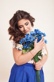 Beautiful girl in a dress with blue flowers stock photography