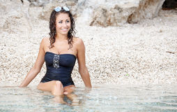 Beautiful girl in dress on the coast Stock Images