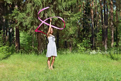 Beautiful girl in dress, is engaged in rhythmic gymnastics Stock Photography