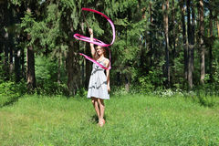 Beautiful girl in dress is engaged in rhythmic gymnastics Royalty Free Stock Photo