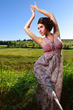 Beautiful girl in dress on field Royalty Free Stock Image