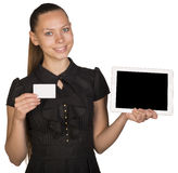Beautiful girl in dress holding blank white card Royalty Free Stock Photography