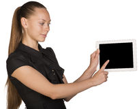 Beautiful girl in dress holding tablet and Royalty Free Stock Photos