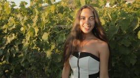 Beautiful girl in dress posing near the vineyards stock video footage