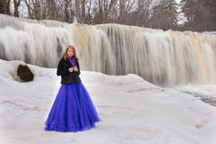 Beautiful girl in a dress  posing by the waterfall Stock Images