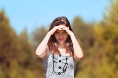 Beautiful girl in dress stands Stock Image