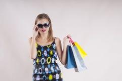 Beautiful glamour girl ,dress sunglasses shopping bagsemotion studio Stock Photography