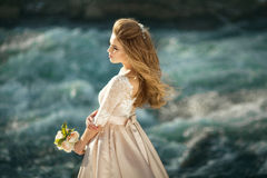 Beautiful girl in a dress. Beautiful young girl in a chic dress in the nature next to the river Royalty Free Stock Photography