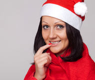 A beautiful girl dressed as Santa Claus Stock Image
