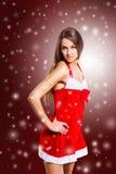 Beautiful girl dressed as Santa Claus Royalty Free Stock Photos