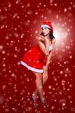 Beautiful girl dressed as Santa Claus Stock Photos