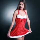 Beautiful girl dressed as Santa Claus . isolated on black. Photo with copy space Stock Image
