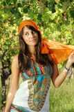 Beautiful girl dressed gypsy style in a vineyard Stock Photo