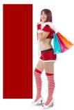 Beautiful girl dressed like Santa with Christmas presents Stock Photography