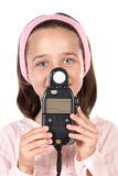 Beautiful girl dressed in pink with photometers Stock Image