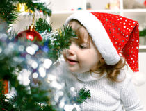 Beautiful girl dressed in a Santa Claus hat Royalty Free Stock Images