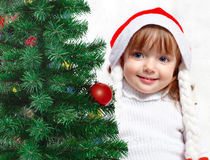 Beautiful girl dressed in a Santa Claus hat Royalty Free Stock Photo
