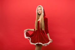 Beautiful girl dressed in santa claus over a red background Royalty Free Stock Photography
