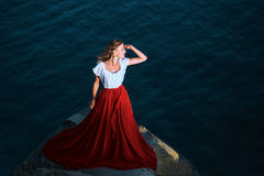 Beautiful girl dressed in white and red dress Stock Photography