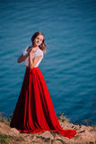 Beautiful girl dressed in white and red dress Stock Images