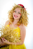 Beautiful girl dressed yellow with wheaten ears Royalty Free Stock Images
