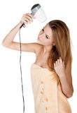 Beautiful girl dries hair by hairdrier Royalty Free Stock Image