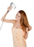Beautiful girl dries hair by hairdrier Stock Photography