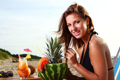 Beautiful Girl Drinkig Fruit Cocktail on the Beach Royalty Free Stock Photo