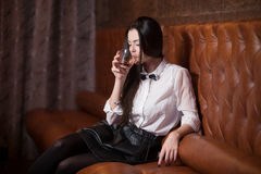 Beautiful girl drinking alcohol Stock Images
