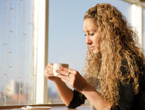 Beautiful girl drinking a cappuccino Royalty Free Stock Image