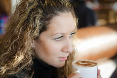 Beautiful girl, drinking a cappuccino Stock Photography