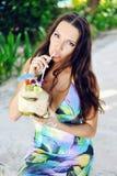 Beautiful girl drinking coconut juice Stock Image