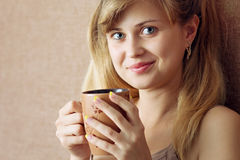 Beautiful girl drinking coffee in bed Royalty Free Stock Photo