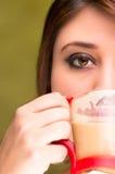 Beautiful girl drinking coffee Stock Image