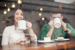 Beautiful girl drinking coffee on a date Stock Photo