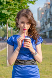 Beautiful girl is drinking coffee in front of buildings in a Eur Royalty Free Stock Images