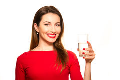 Beautiful Girl Drinking a Glass of Pure Water Smiling. On White Stock Image