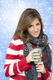 Beautiful girl drinking hot drink snowflakes backr Royalty Free Stock Photo