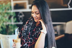 Beautiful girl drinking ice mocha shake in a cafe stock photography