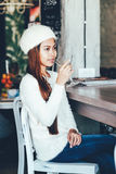 Beautiful girl drinking Martini in a bar. Beautiful girl in white long sleeve drinking martini in a bar Royalty Free Stock Photography