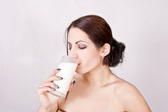 Beautiful girl drinking milk Royalty Free Stock Photography