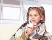 Beautiful girl drinking milk Stock Photo