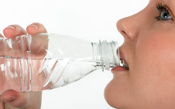 Beautiful girl drinking mineral water Stock Photo