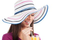 Beautiful girl drinking orange juice. Stock Photos