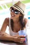 Beautiful girl drinking in the pool bar. Stock Photography