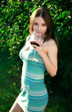 Beautiful girl is drinking red wine Royalty Free Stock Photography